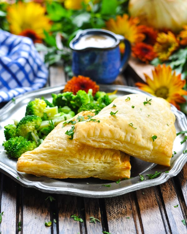 Two Turkey Pot Pie Pockets on a plate with broccoli