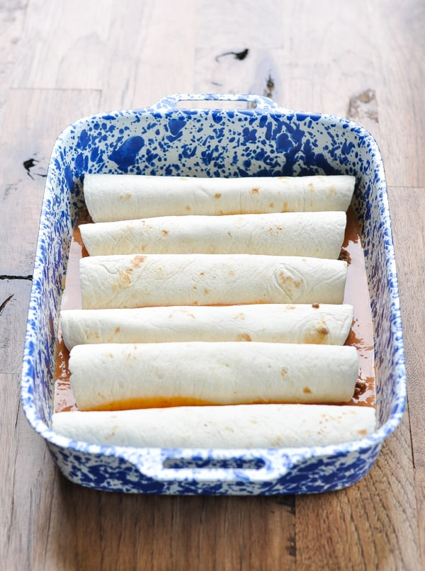 Beef enchiladas in a baking dish before they go in the oven