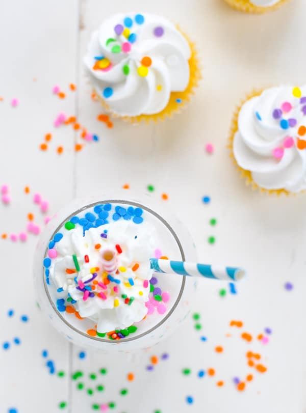 Overhead image of cake batter healthy smoothie and cupcakes