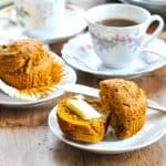 Healthy pumpkin muffin on plate with butter and text overlay