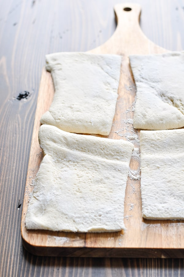 Pizza dough cut into 4 quarters