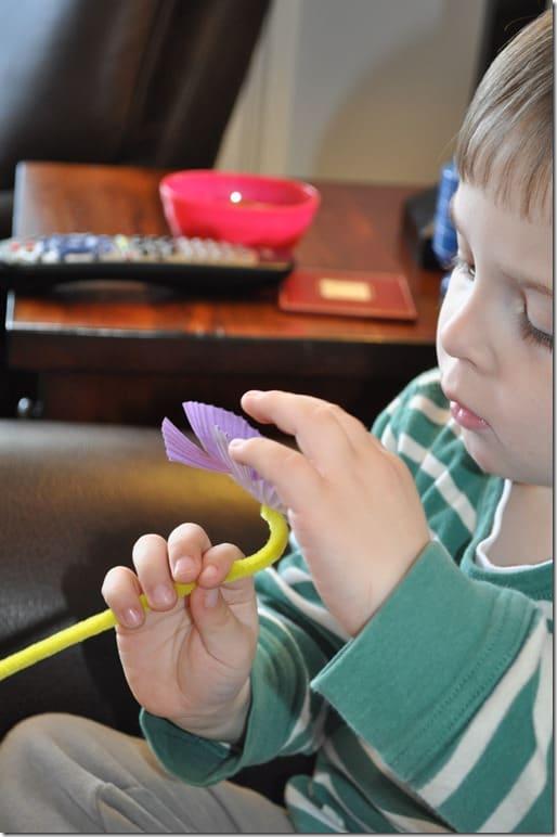 G putting sticker on flower