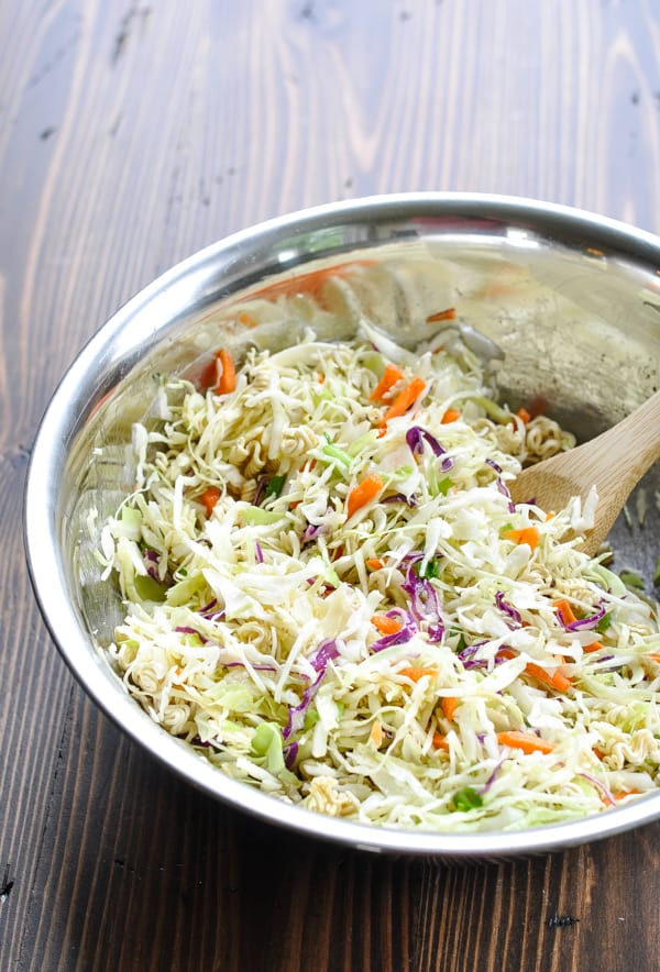 Ramen Noodle Salad in a metal mixing bowl with wooden spoon