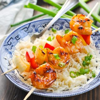 Easy grilled shrimp recipe with vegetables on a bowl of rice