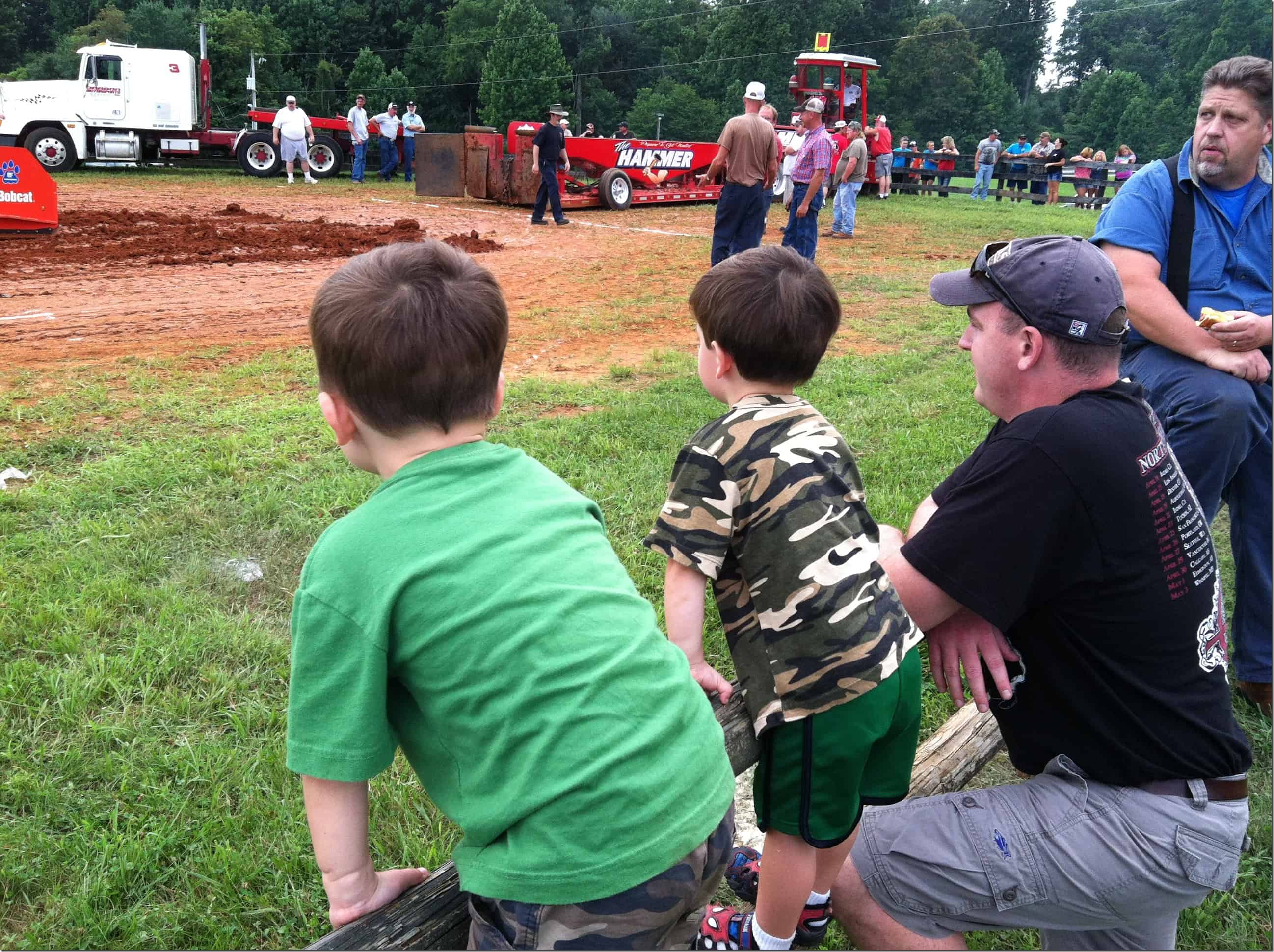 Tractor Pull Boys on Fence