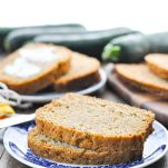 Easy zucchini bread recipe on a plate with text overlay