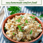 Side shot of a bowl of chicken and stuffing casserole with parsley on top and a box at the top with the text title