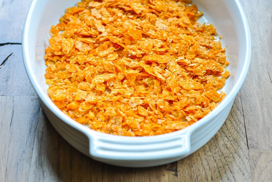 Crushed Doritos in baking dish for taco casserole