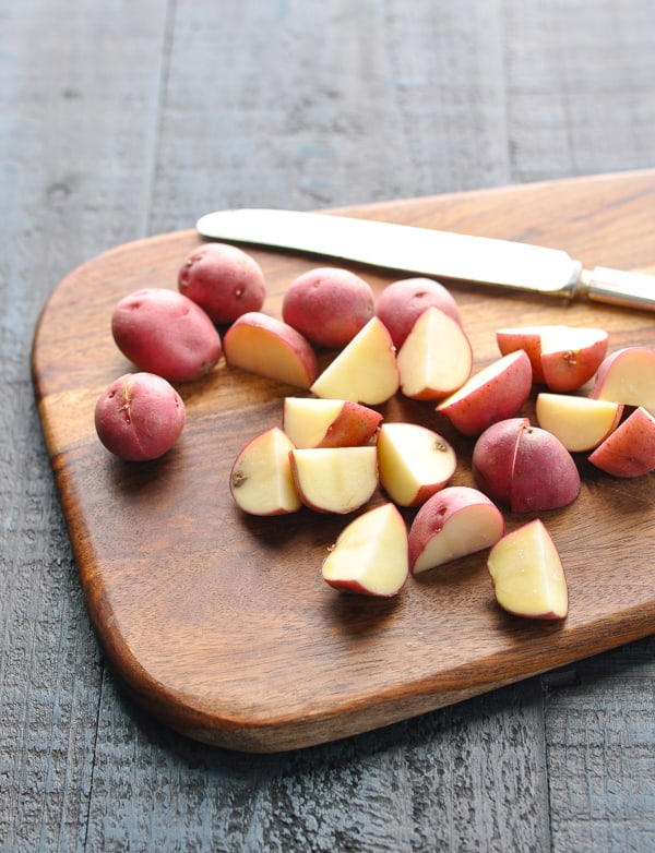 Diced red potatoes on a cutting board