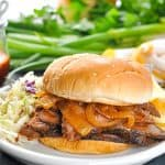 Slow Cooker Brisket Sandwich on a plate with text overlay