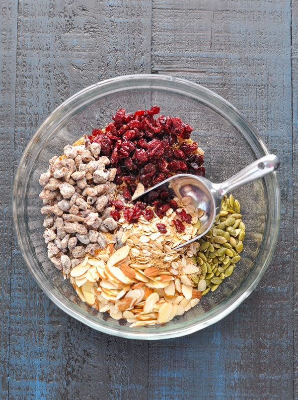 Muesli ingredients in a glass mixing bowl