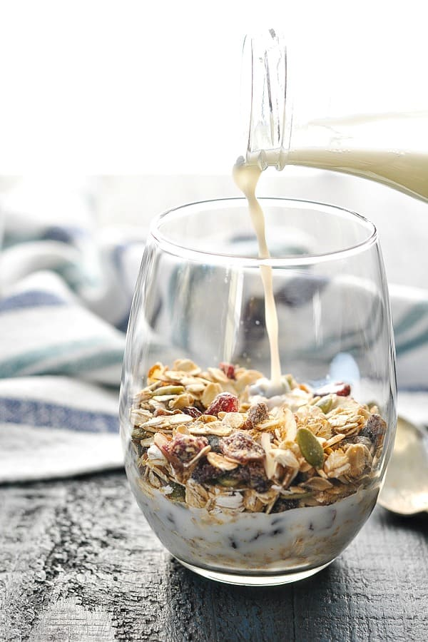 Pouring milk over bowl of Swiss muesli