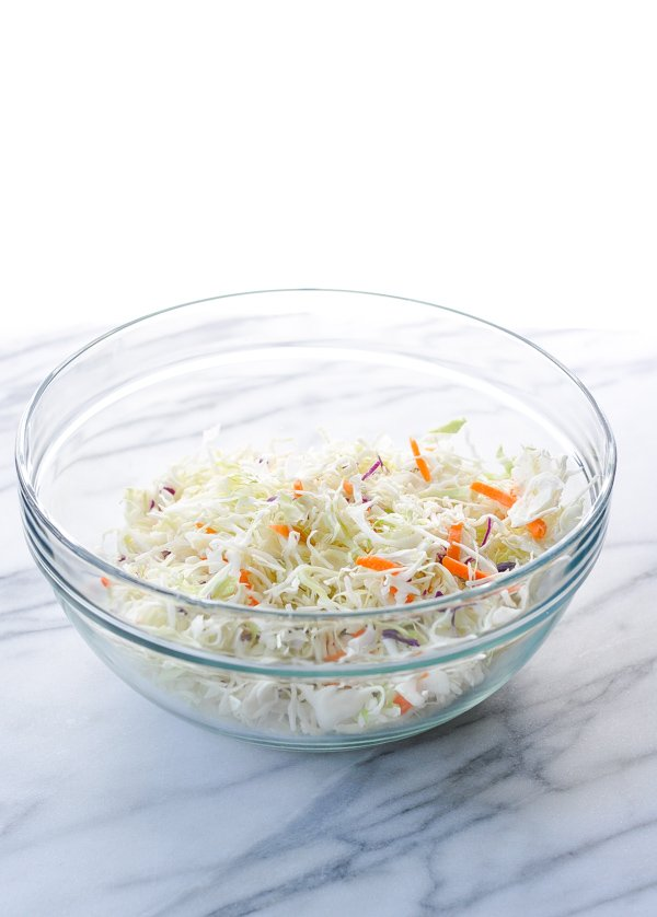 Glass bowl full of coleslaw mix