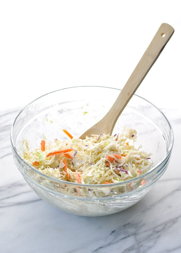 Coleslaw in a glass mixing bowl