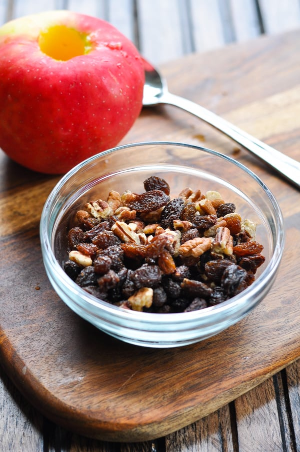 Bowl of raisins and pecans for stuffed baked apples