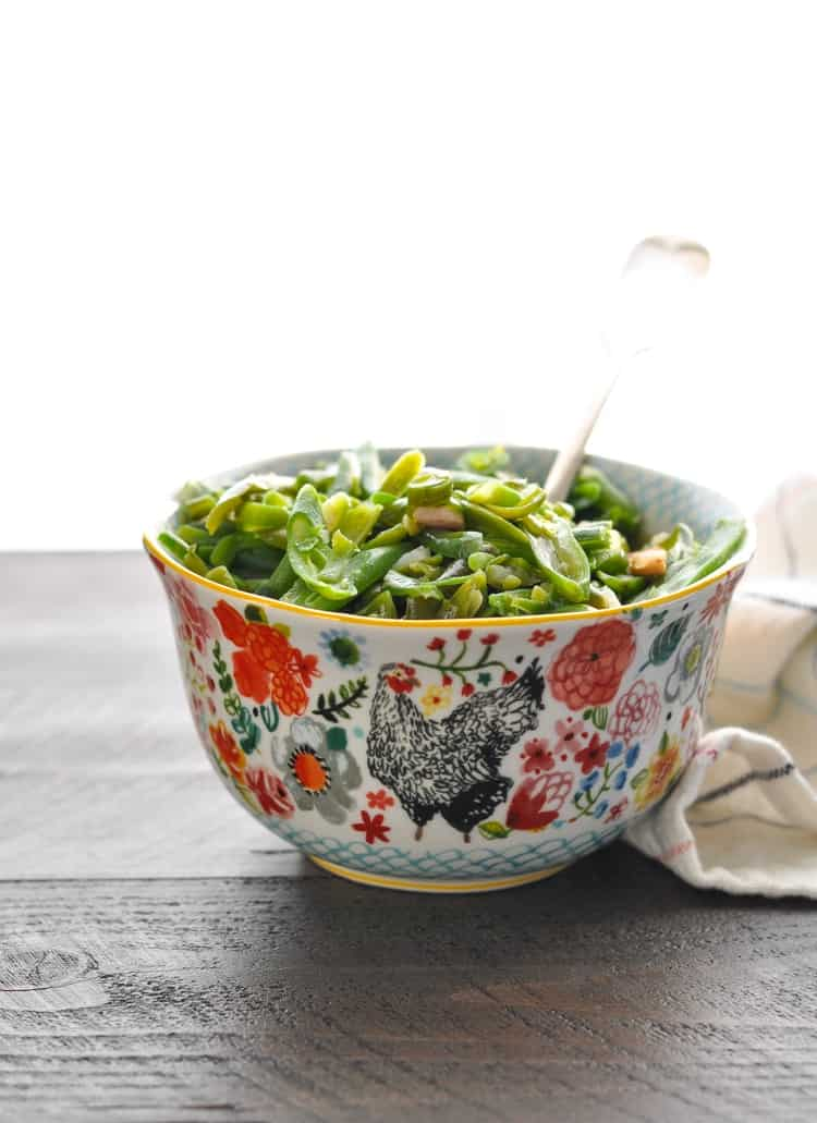 Bowl of Southern Green Beans with a serving spoon