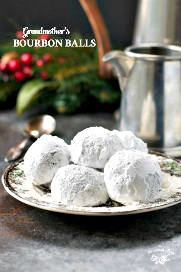 Plate of Grandmother's Bourbon Balls no bake and coated with powdered sugar