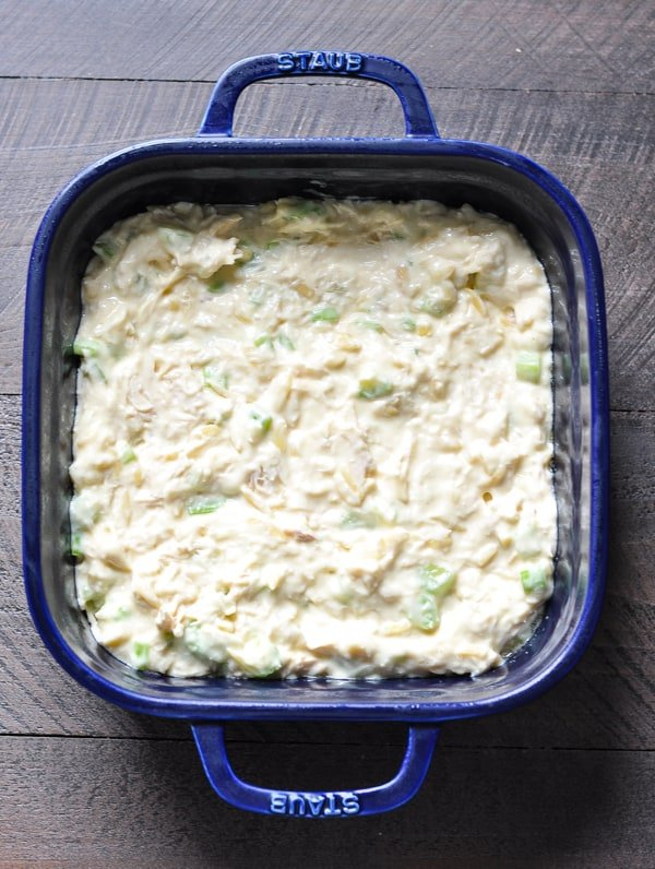 Overhead image of chicken salad in blue dish before baking