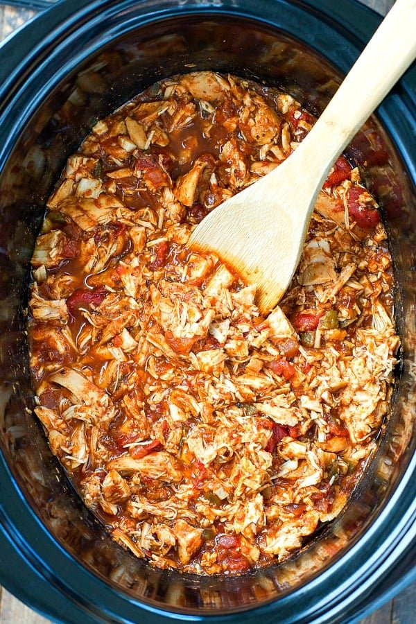 Overhead shot of shredded Mexican chicken in a slow cooker