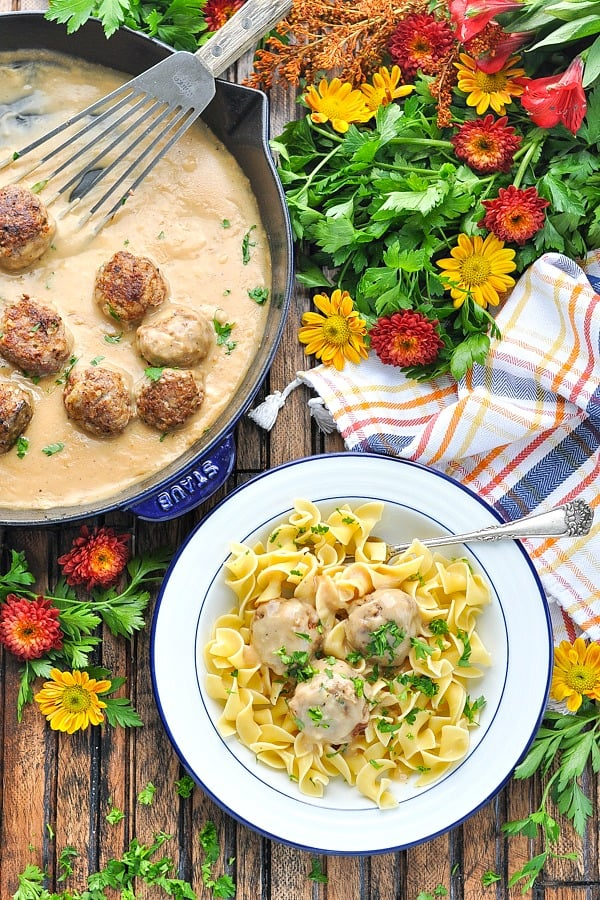Overhead image of skillet and bowl of authentic swedish meatballs recipe
