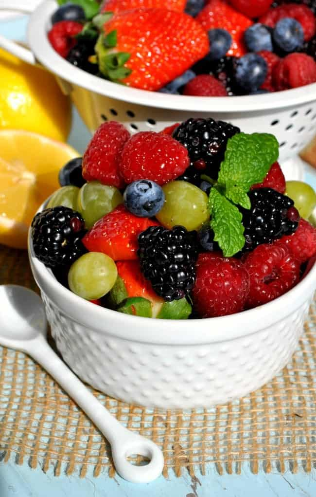 Fresh fruit salad in a bowl with honey lemon dressing