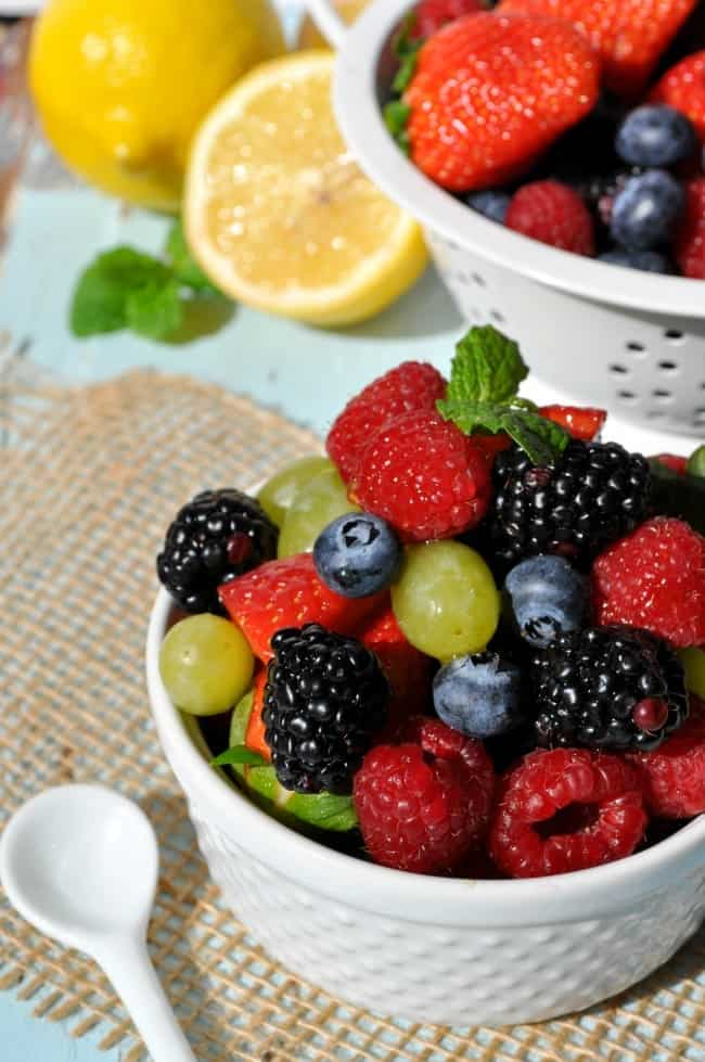 A fresh fruit salad with honey lemon dressing makes the perfect side dish for your next potluck picnic!