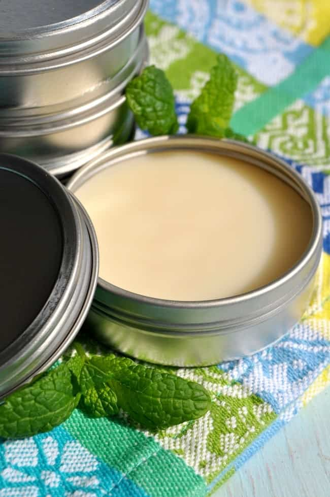 Round metal tin of homemade lip balm.