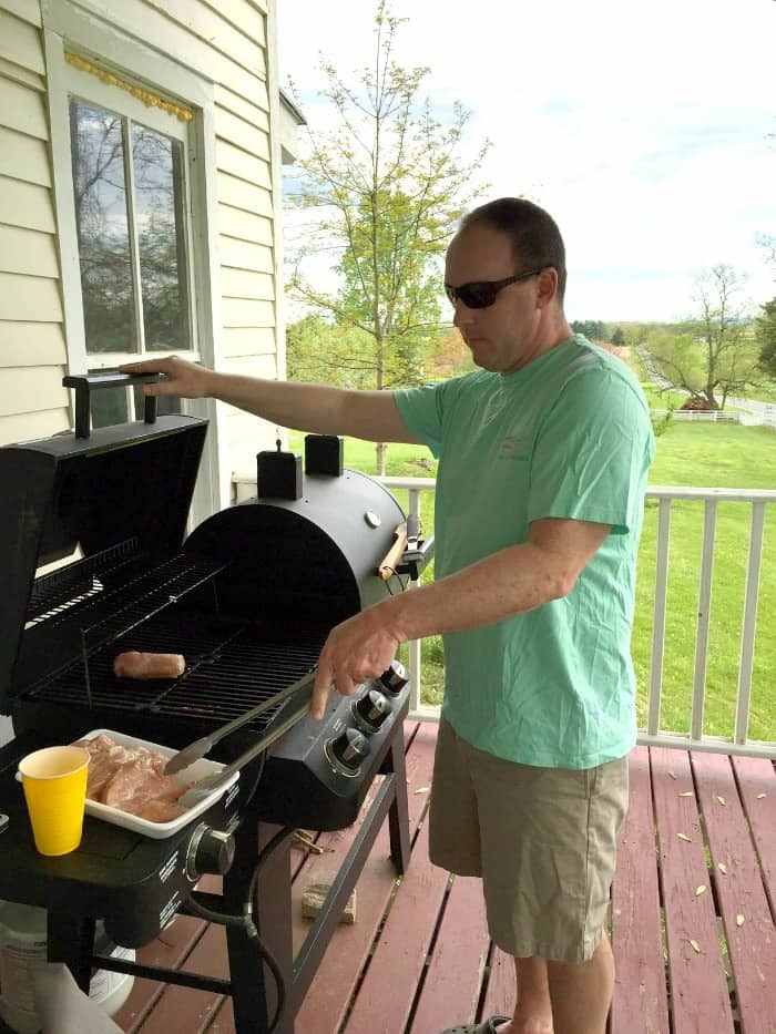 A man Grilling chicken breasts