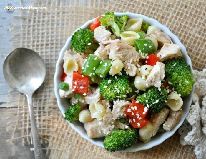 Sesame Chicken Pasta Salad in a bowl with broccoli and other veg