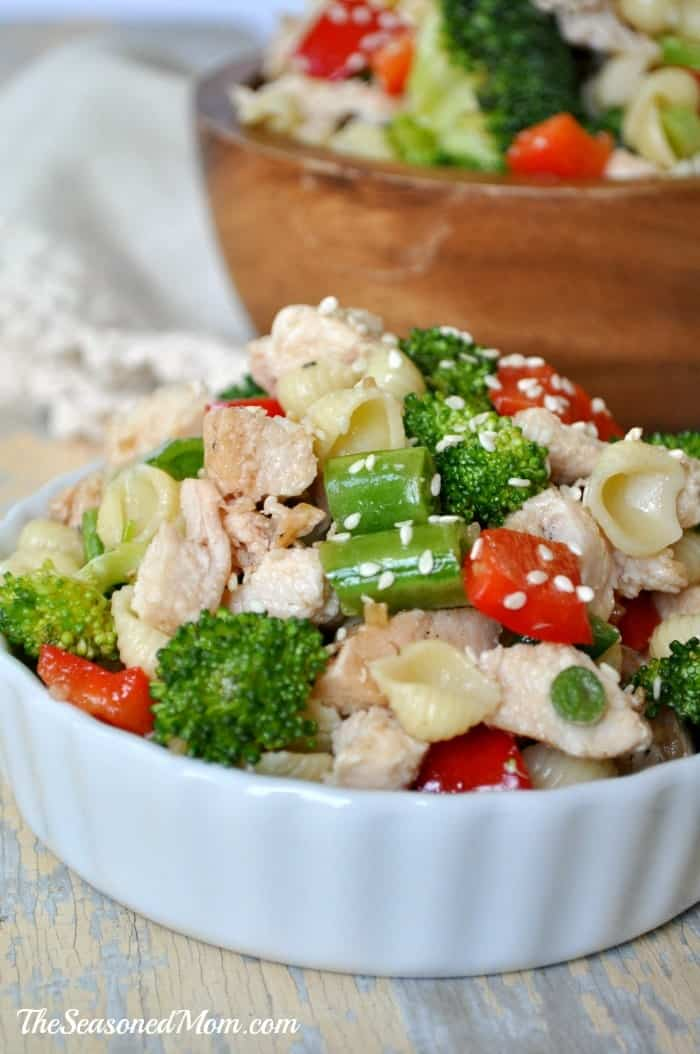A close up of a Sesame Chicken Pasta Salad in a white bowl