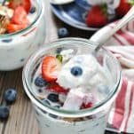 Spoon scooping up overnight oatmeal in a jar