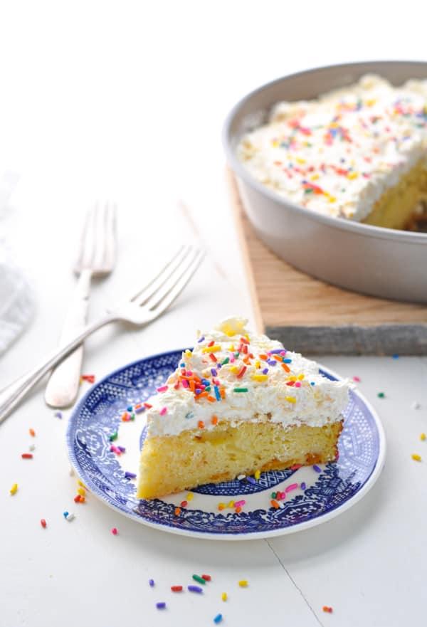 Slice of pineapple orange cake on a plate.