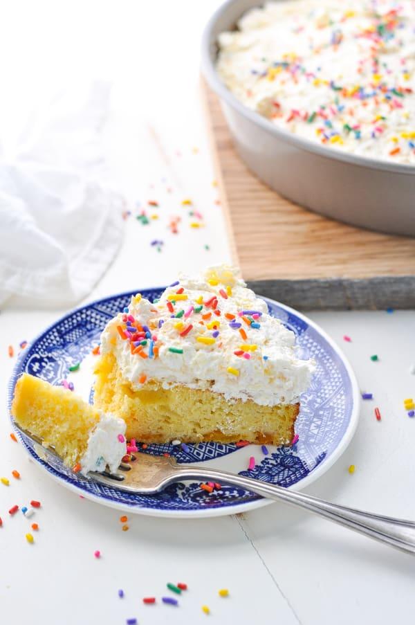 Bite of pineapple orange cake on a plate for an easy dessert.