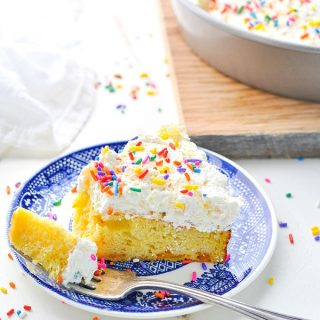 Slice of orange pineapple fluff cake for an easy dessert recipe!