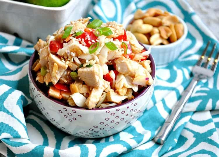 Thai Peanut Chicken Salad in a bowl with a fork at the side