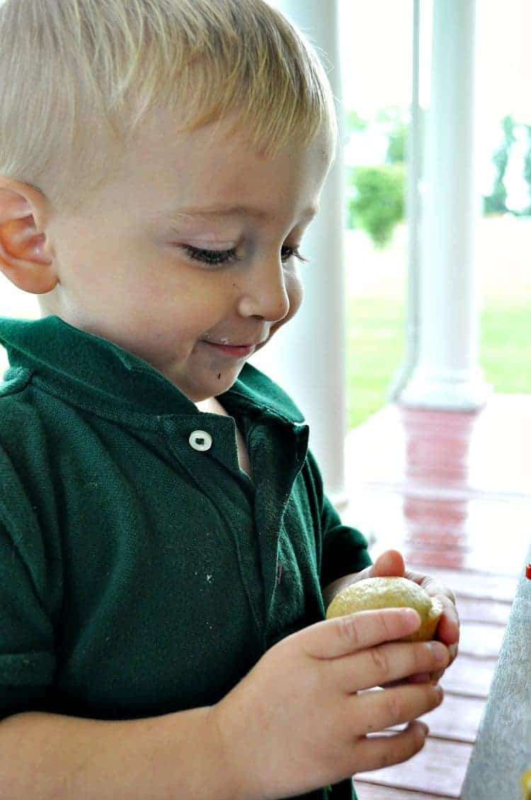 A boy eating Graham Cracker Blender Muffins