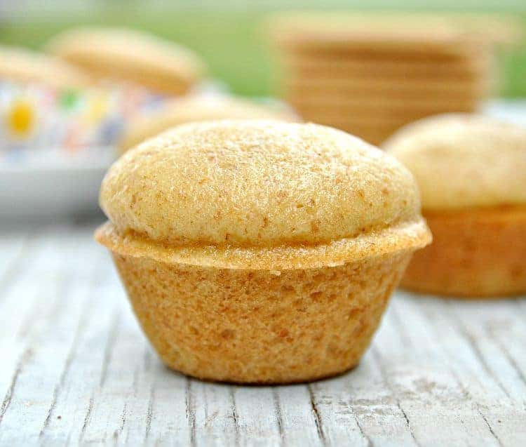 A close up of Graham Cracker Blender Muffins sitting on a wooden surface