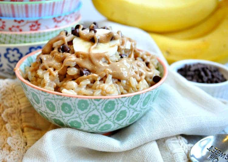 A side shot of a Healthy Chunky Monkey Rice Bowl drizzled with nut butter