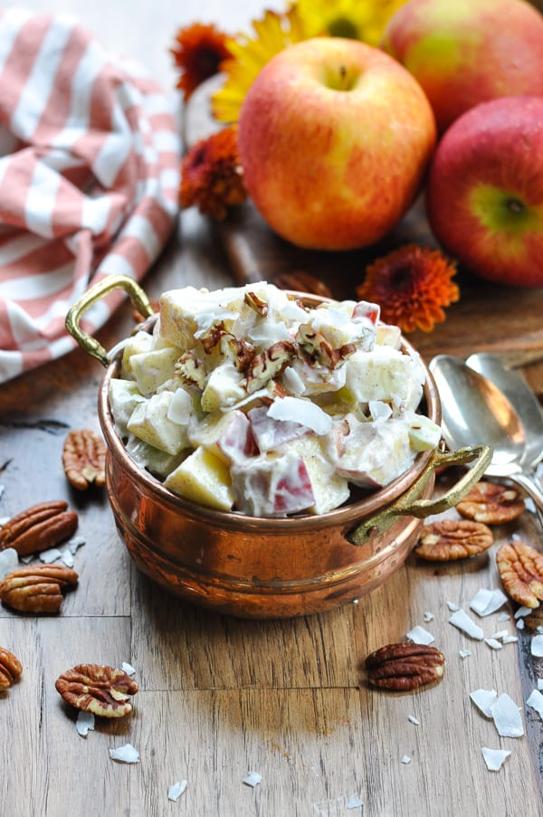 Overhead image of bowl of apple salad topped with pecans