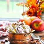 Copper bowl of apple salad with text overlay