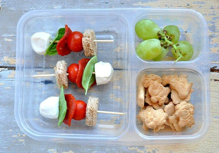 Pepperoni Pizza Sticks in a lunch box with grapes and cookies