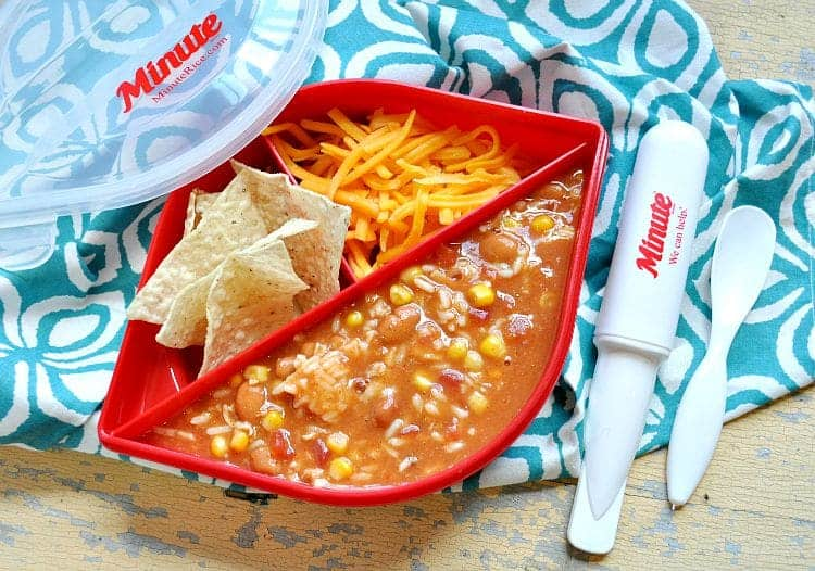 Mexican chicken and rice soup in a lunch box container with rice and chips