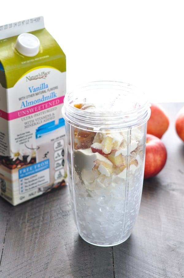 Vegan apple pie smoothie ingredients in a blender