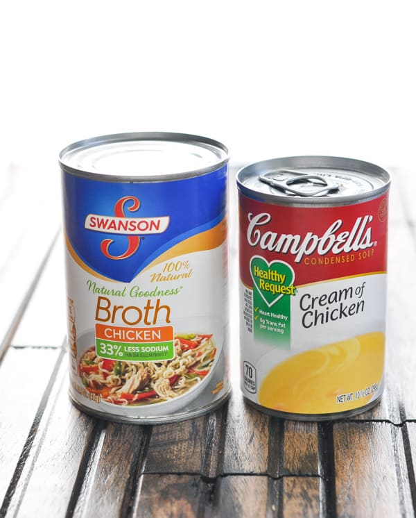 Chicken broth and cream of chicken soup cans for Cowboy Casserole sauce