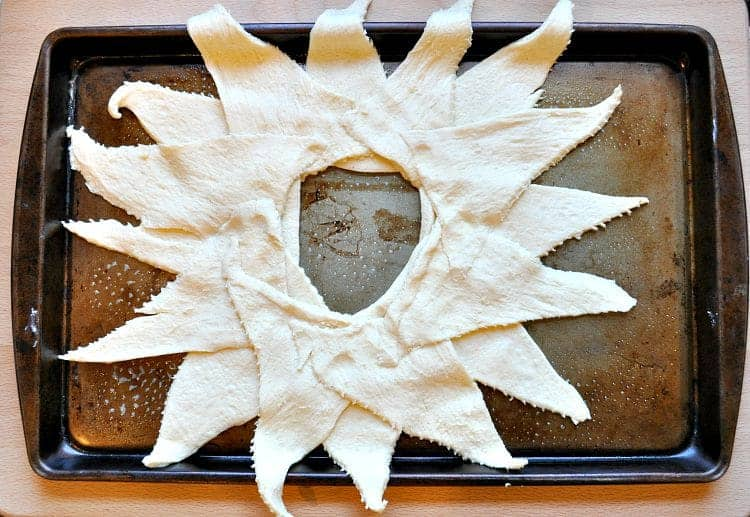 Pastry on a tray for making a crescent ring