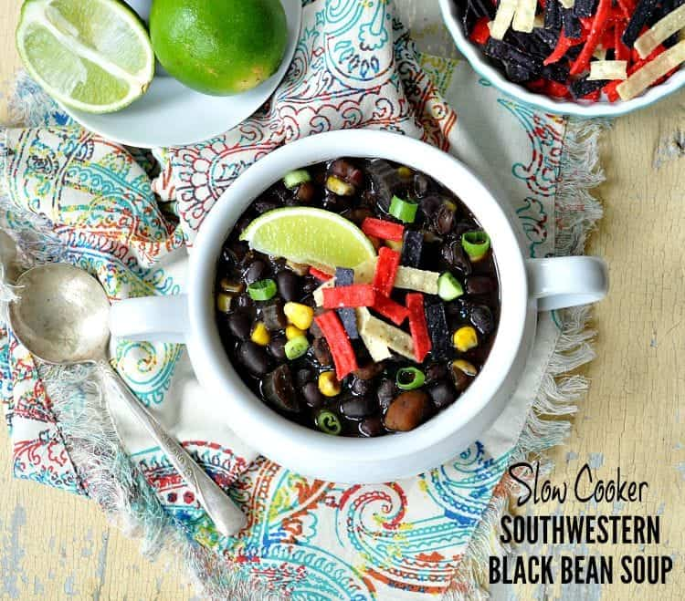 An overhead shot of a slow cooker black bean soup in a white bowl