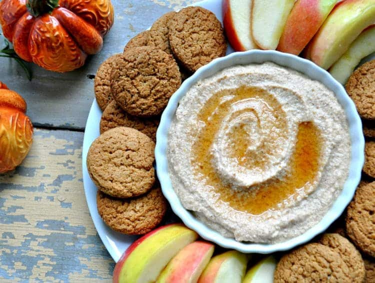 An overhead shot of Pumpkin Spice Whipped Ricotta with sliced apples and cookies