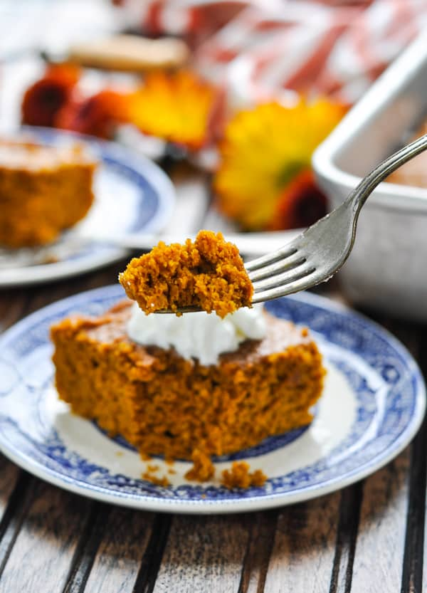 Bite of pumpkin gingerbread cake on a fork