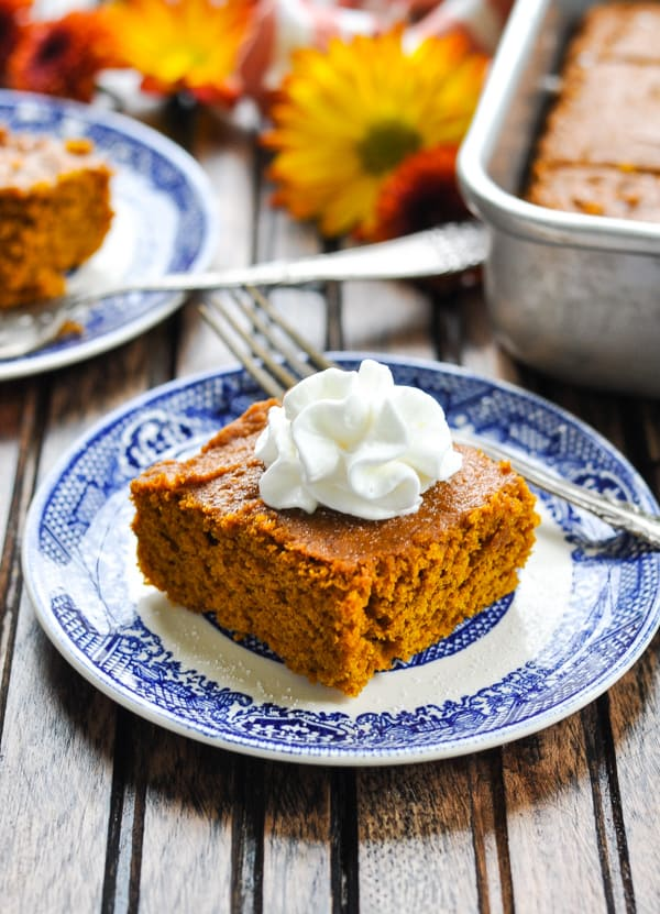 A slice of pumpkin gingerbread cake on a blue and white plate