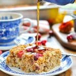 Pouring maple syrup on healthy baked oatmeal with text overlay on image